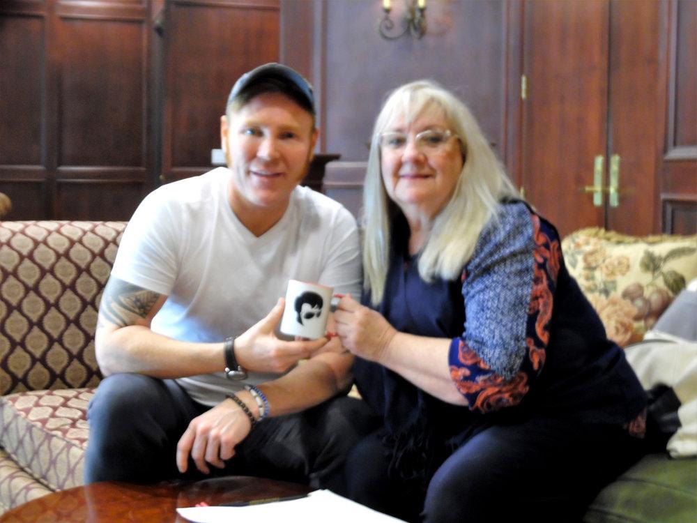 Gordon accepting the SIDEBURNS thank you mug from Carolyn.