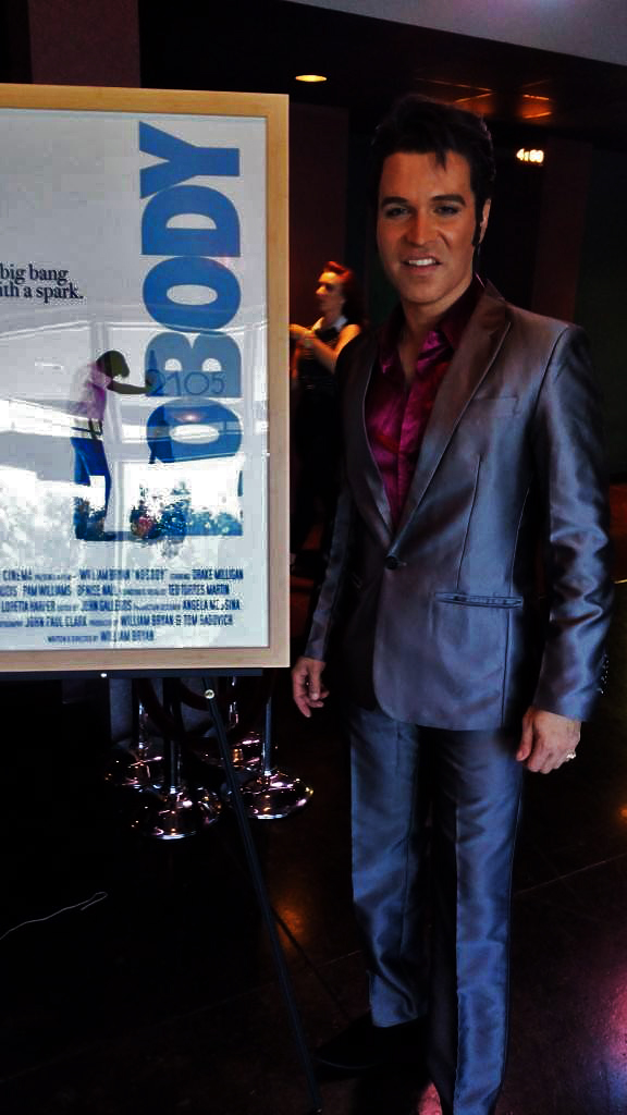 ETA  Ted Torres Martin,  vocalist for the soundtrack of the Elvis based independent short film  NOBODY , poses with poster, October 20th, 2016.   Photo provided by Ted Torres Martin.