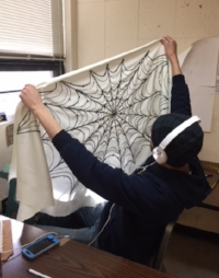 Michael Polston working on a new Web Cape.   Photo Credit:  Kim Polston.