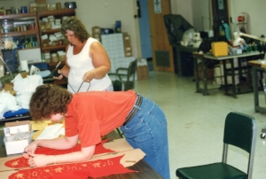 Kim and Butch Polston's Aunt Gayle working on jumpsuits, early 1990s.   Photo Credit:  Butch Polston.