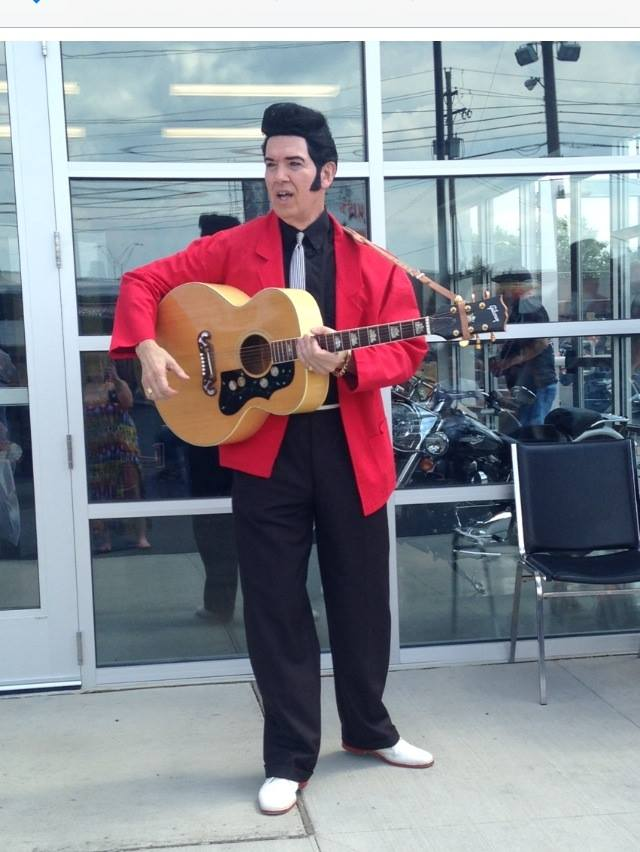 ETA  Mark Lee Pringle  performs at the Grand Opening of a Harley-Davidson store.   Photo Credit:  Brenda Pringle.
