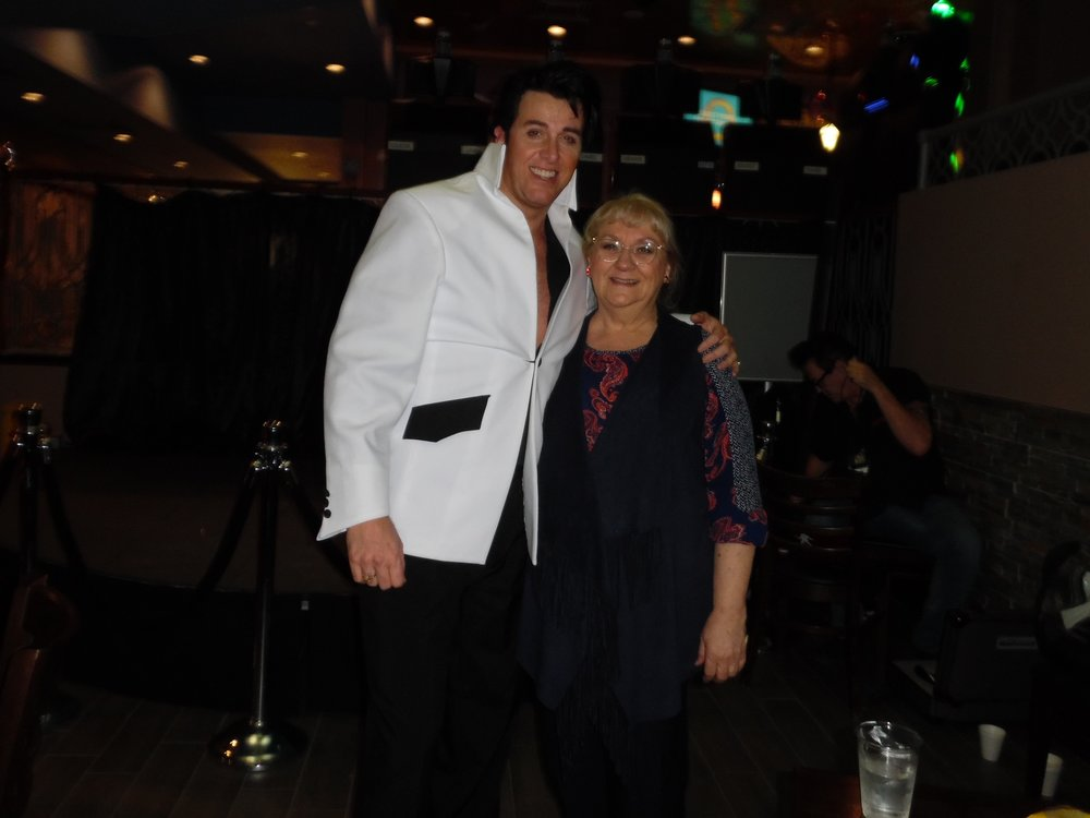 ETA  Matt Cage  poses with Carolyn MacArthur, Editor of SIDEBURNS Magazine after Matt's amazing concert.