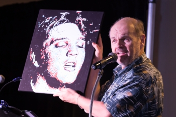 Victor J Hanson holding one of Marcus Wells' beautiful paintings of Elvis Presley.   Photo Credit:  Louis Young Photography.