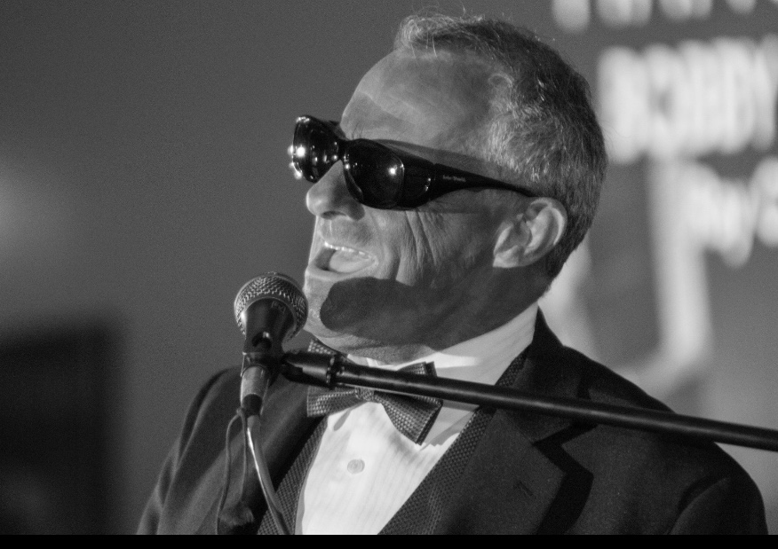 "Entertainer Bobby Allan in his in his award winning  tribute to Ray Charles.   Photo Credit:  Clarence ""Buck"" O'Dell."