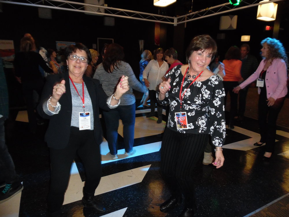 Sisters, Ruth Freeland (L) from Richmond Hill, ON, and Doris Balsdon (R) from Kitchener, ON, danced the evening away on the Greg Frewin Theatre dancefloor after Saturday's day two of competition.   Photo Credit:  Carolyn MacArthur.