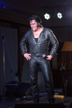 ETA  Tim E Hendry  wearing black leather in his first set.  Photo Credit: Lori-Anne Crewe, LA Crewe Photography.