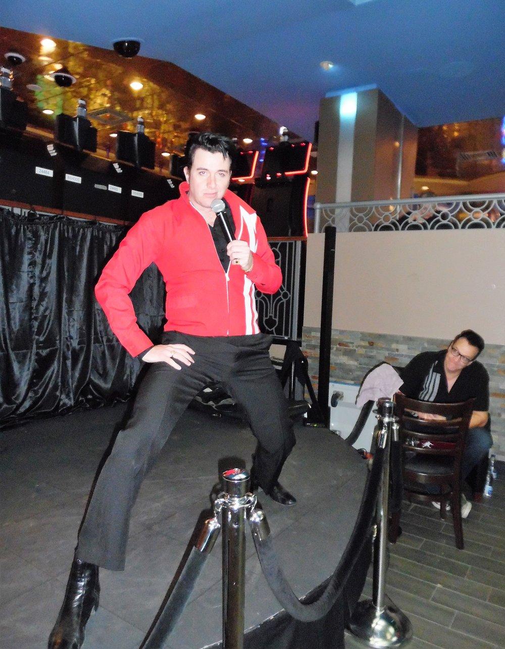 ETA  Matt Cage  strikes a pose at Flamboro Downs as an amused ETA Brent Freeman looks on.  Photo Credit: C.M.