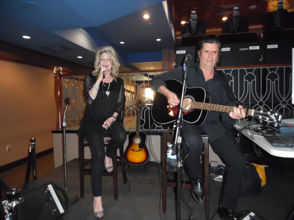 Jim has performed with many ETAs, including Matt Cage, Dean Z, Justin Shandor, Connor Russo, and Grahame Patrick. Jim is pictured here with his wife, Pam, during their performance at Elements/Flamboro, Friday, May 18th, 2018.  Photo Credit: C.M.