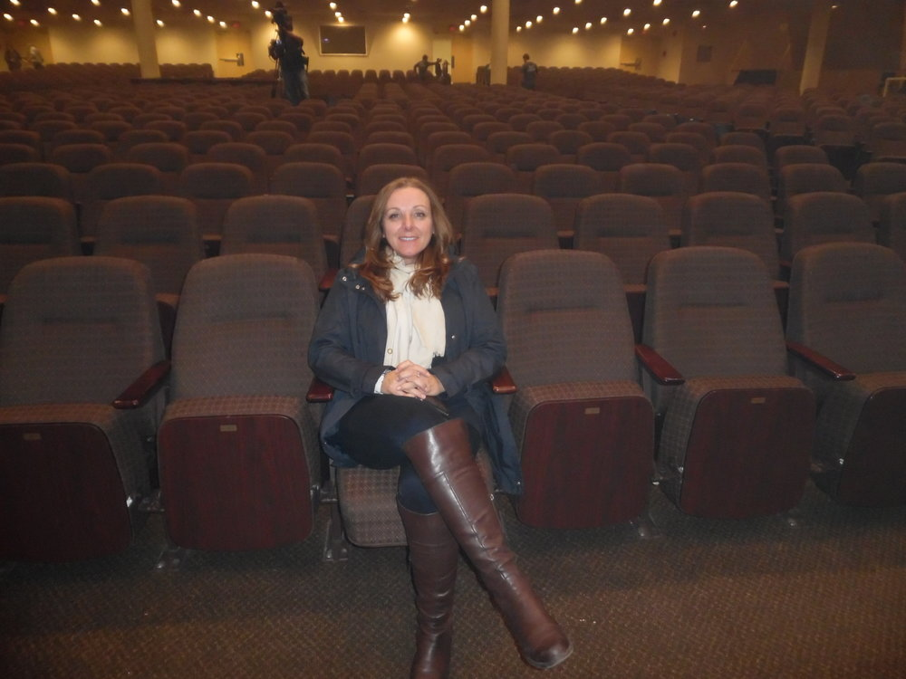 "Lisa sitting in the ""foggy"" theatre of the Church on the Queensway after  ETA  Thane Dunn 's  show.   Photo Credit:  C. MacArthur."