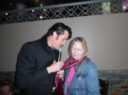 ETA  Matt Cage  serenades a lucky lady and gives her a scarf during his Element/Flamboro performance. .  Photo Credit: Carolyn MacArthur.