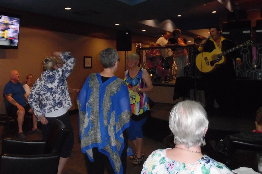 Someone unexpectedly took this photo with my camera.  Thank you for capturing a moment that demonstrates why we all had such a great time at Flamboro Downs.  In addition to the fantastic entertainment provided by ETAs, we were encouraged to dance, mingle, and participate.   Photo Credit:  ?