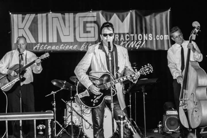 ETA  Brent Freeman , wearing his Elvis '68 Comeback Special black leather pants, is shown performing with the Tiger Sharks at a King Trilogy event in 2015.  Photo provided by Brent Freeman.