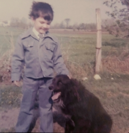 Andrew Martin at age four with his dog, Snoopy.