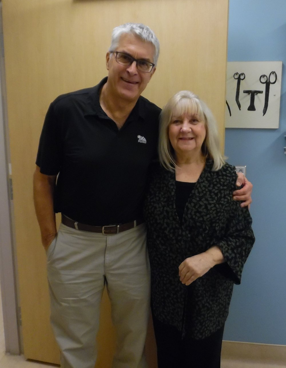 Dr. de Beer graciously posed for a photo with his patient, Carolyn MacArthur, Editor of SIDEBURNS Magazine.