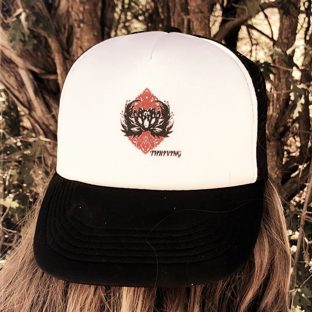 - For every THRIVING hat sold 100% goes directly into Healing Through Yoga scholarship fund so trauma survivors who wish to heal and need additional financial support to participate, can!  Red Bill Trucker Hats $15.00. Black Bill Trucker Hats $15.00.