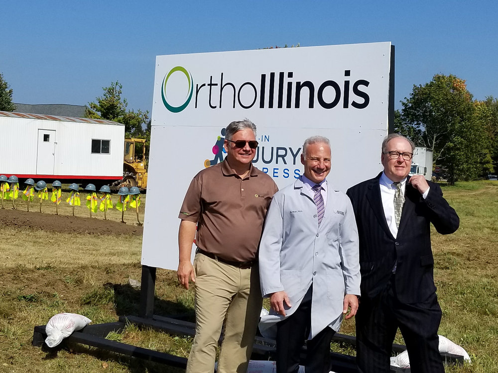 Left to right : Brent Johnson, President Ringland Johnson Construction.Dr.Brian J Bear, Chairman OrthoIllinois, Frank Talbert, Principal ObraWerks