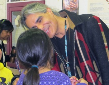 Musician and filmmaker Robby Romero chats with a student Thursday at Taos Pueblo Day School, where he launched his Project Protect Awareness Campaign.