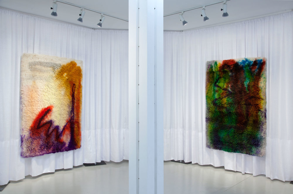 (Left)  The liquidity of anything, 2017,  wool rug, acid dye, hairspray, chalk.5′ x7′ (Right)  Swiping my screen with a finger, 2017, w ool rug, acid dye, hairspray, chalk.5′ x7′
