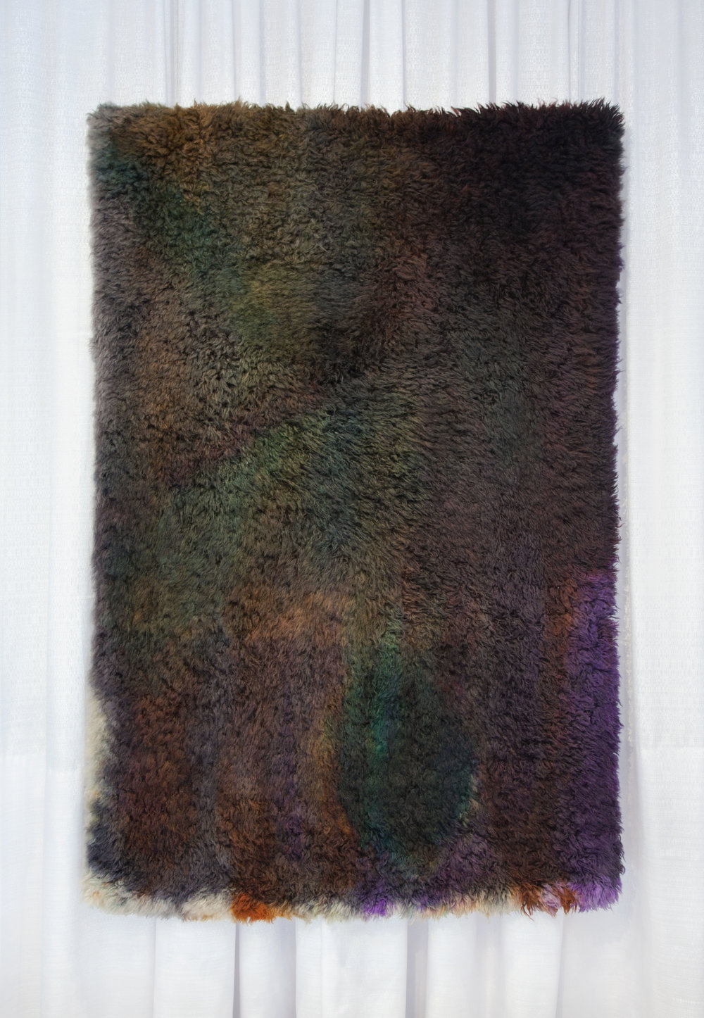 Before capillary action completes,  2017,   wool rug, acid dye, hairspray.5′ x7′