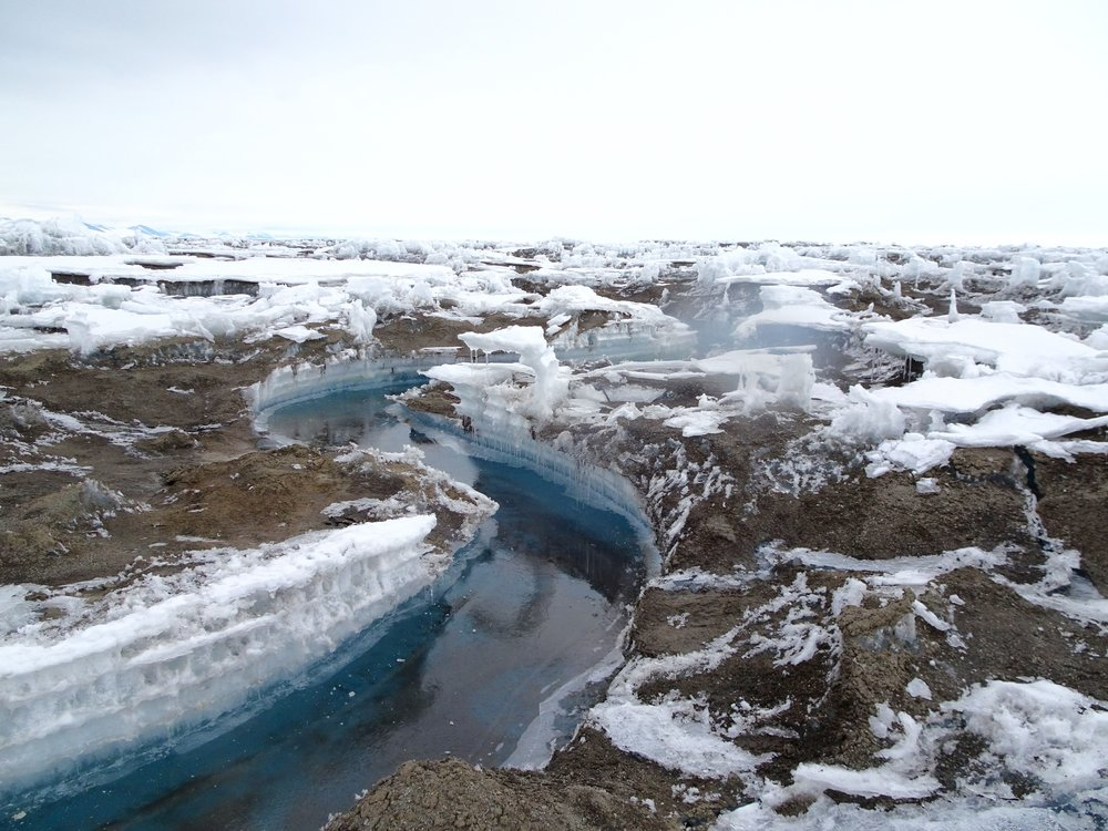 A meltwater stream on the McMurdo Ice Shelf. Note the dirt, this is a characteristic feature of McMurdo. (Photo by me)