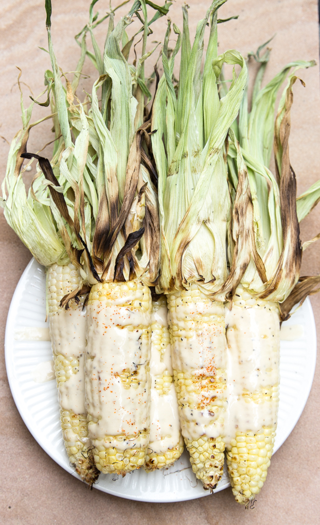 Kick your same old grilled corn for cookouts up a notch with this sweet n' spicy cayenne-tahini drizzle with only 5 main ingredients! #grilledcornrecipe | CheersYears.com.jpg