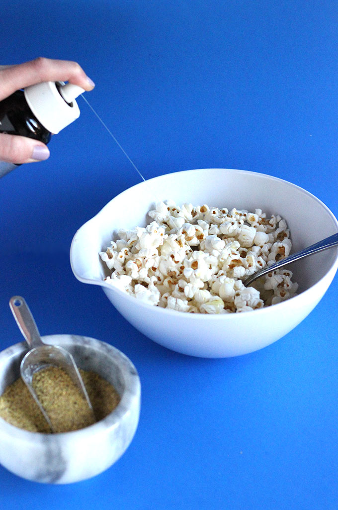 Oil,-popcorn,-and-vegan-cheddar-seasoning-to-make-the-tastiest-healthy-movie-snack!