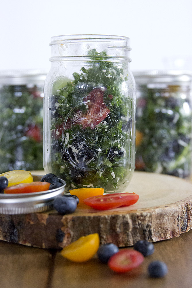 This Carolina Kale Salad Recipe is the perfect make-ahead salad for lunches all week. Made with all local ingredients and stored in mason jars! #kalesalad #kalesaladrecipe #masonjarsalad #mealprep