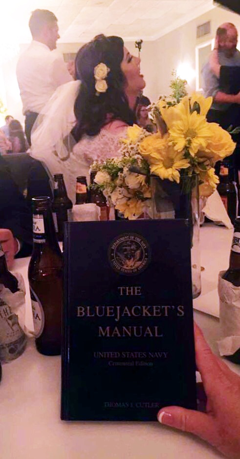 In a recent wedding, The Bluejacket's Manual was used for a groom whom had served in the Navy. The tradition shared at this event was the passing of The Bluejacket Manual from a current Navy wife, to an incoming Navy wife; a special token that can be on display for years to come with multiple meanings to both spouses.