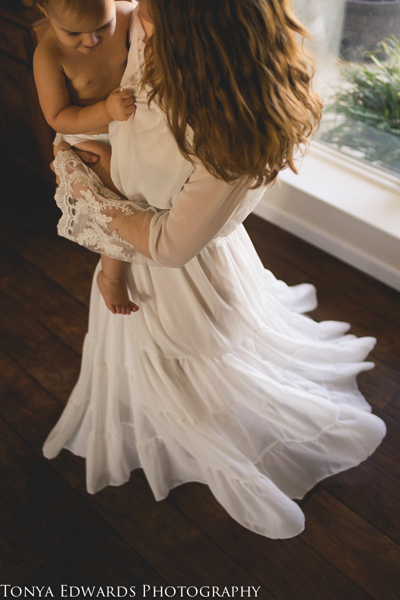 Tonya Edwards | Oroville Photographer | mother in white dress dancing and twirling with baby girl