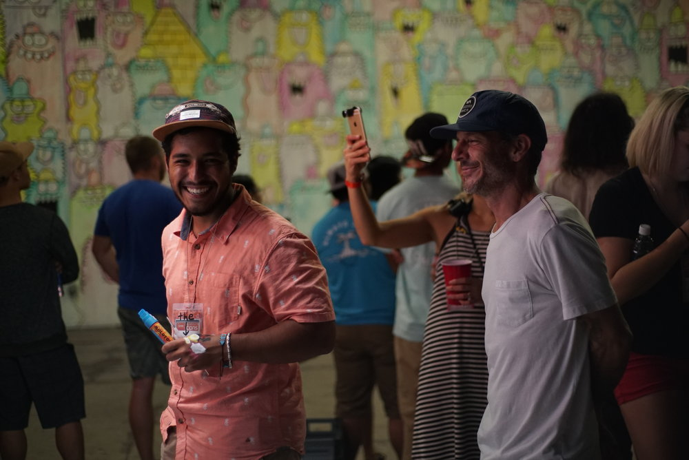 Drigo and Mark Oblow painting at Converse Cons shoe release party hosted by Zumiez and Powwow Hawaii in Honolulu, Hawaii.