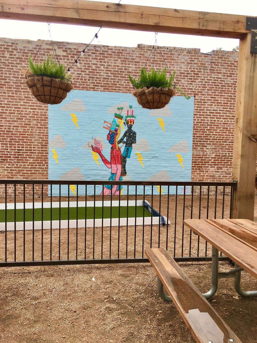 Drigo mural, painting in Deep Ellum, Dallas, Texas on the patio of Easy Slider