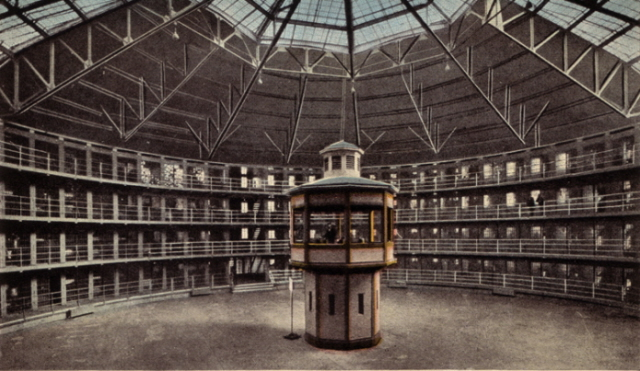 postcard of a panopticon - from which the activity in every cell can be watched…