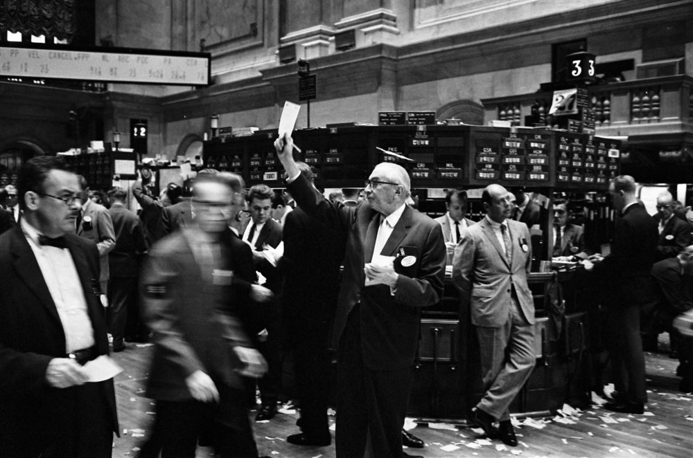 Stock brokers working at the  New York Stock Exchange  in 1963. Thomas J. O'Halloran, photographer [Public domain]
