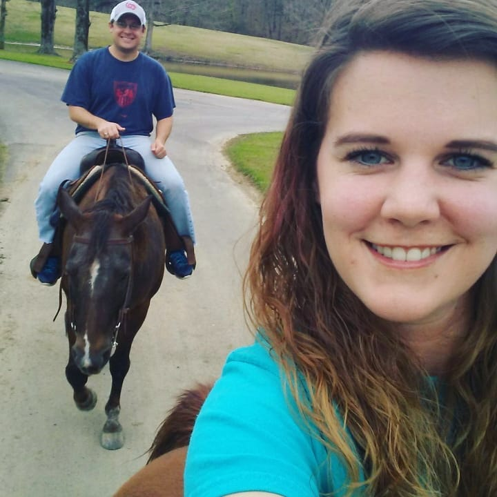 I was very glad to learn how to ride a horse from two experienced riders: my wife (pictured here) and my former student Cody (who was out ahead of us, leading the way).