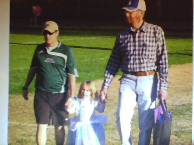 This is one of my all-time favorite pictures of Dad, my older daughter, and me. If you can't tell, she's wearing a Cinderella gown...to a soccer game. She's not concerned about being judged or laughed at because she didn't know any better, and she was confident in the love of those around her.