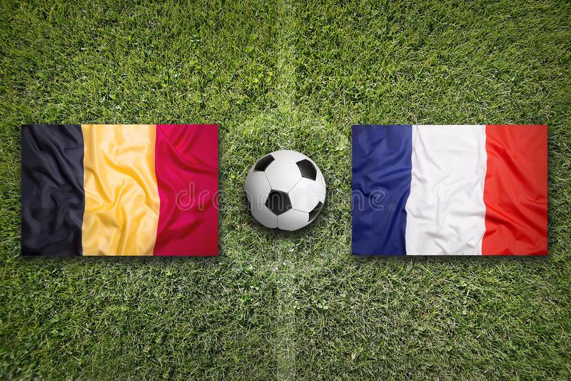 belgium-vs-france-flags-soccer-field-green-71747403.jpg