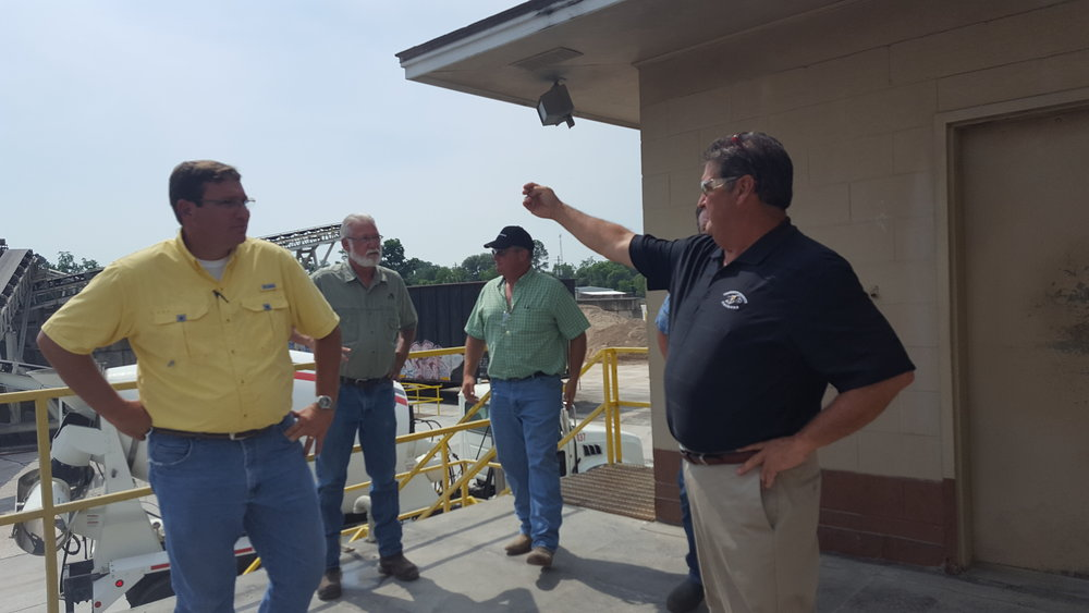 Rusty Ingram, with Scruggs Concrete, gives Rep. Dominic LaRiccia and Rep. John Corbett a plant tour in Valdosta, GA.
