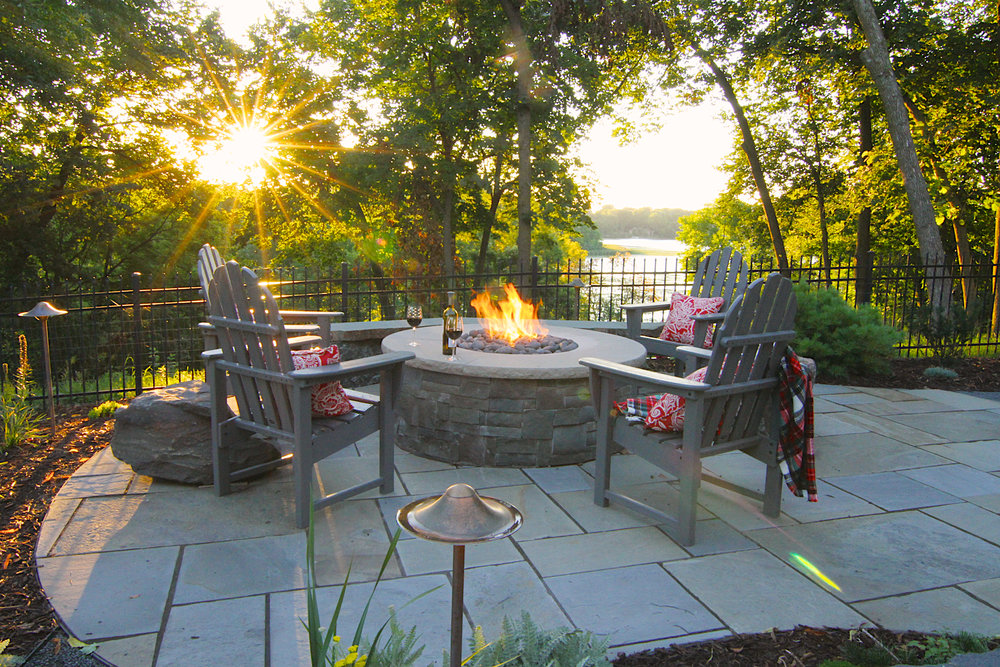 a beautiful sunset view in chanhassen, minnesota. gas fire feature is perfect for the breeze coming off the lake.