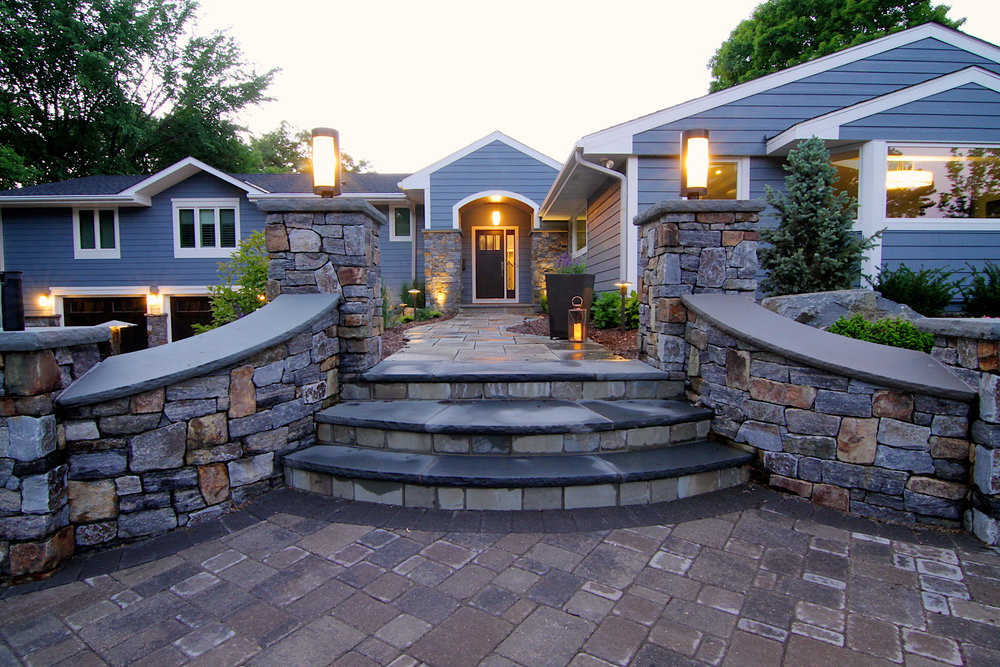 After this Edina home had a full remodel– inside and out– the attention turned to the landscaping. We installed a heated paver driveway with extra spaces for guests, and a welcoming walkway filled with natural stones.