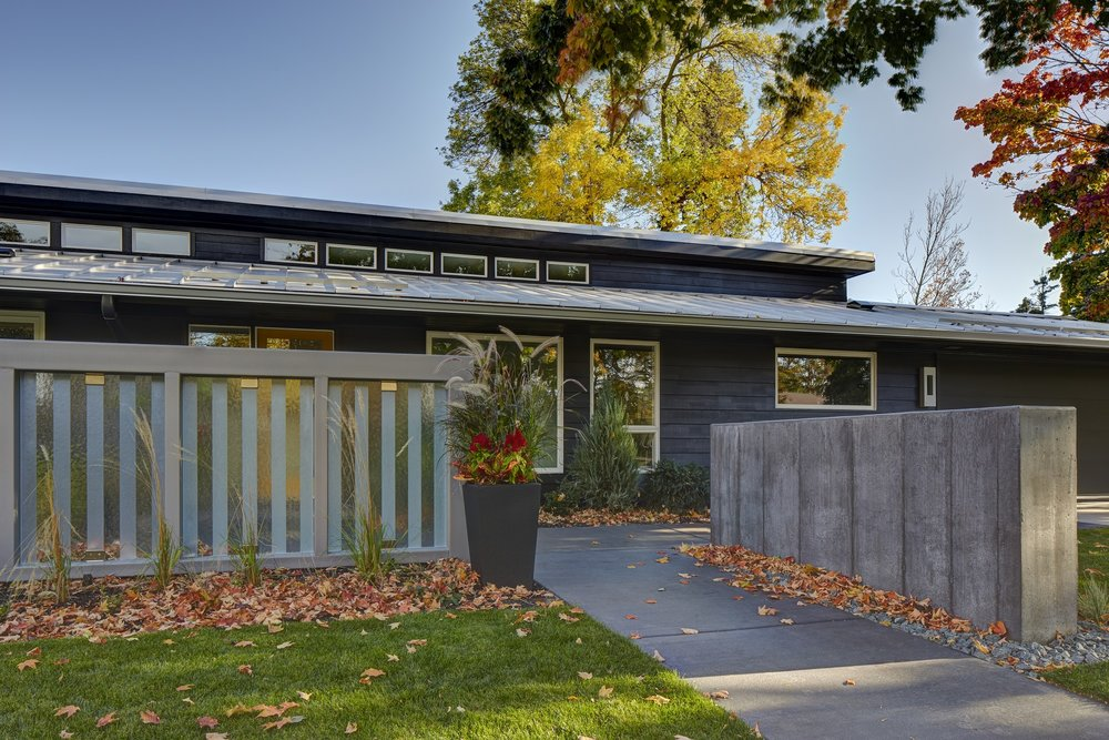 This Midcentury modern home in Edina had our creative wheels turning, adding artistic privacy fences that were modern with the right amount of midcentury.