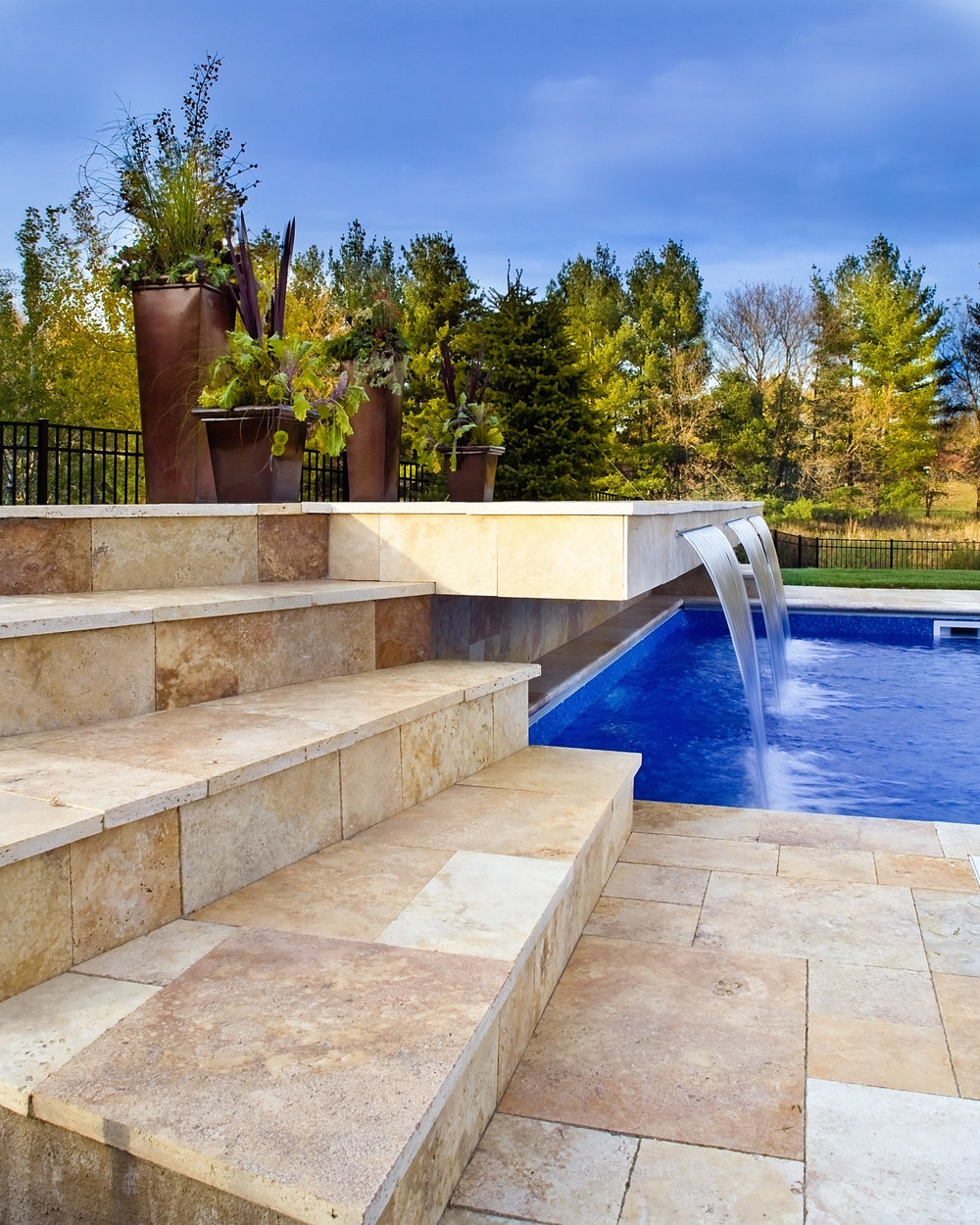Lake Minnetonka area home enjoys a place to jump, sit or enjoy the sun as it overlooks the beautiful stone tile.