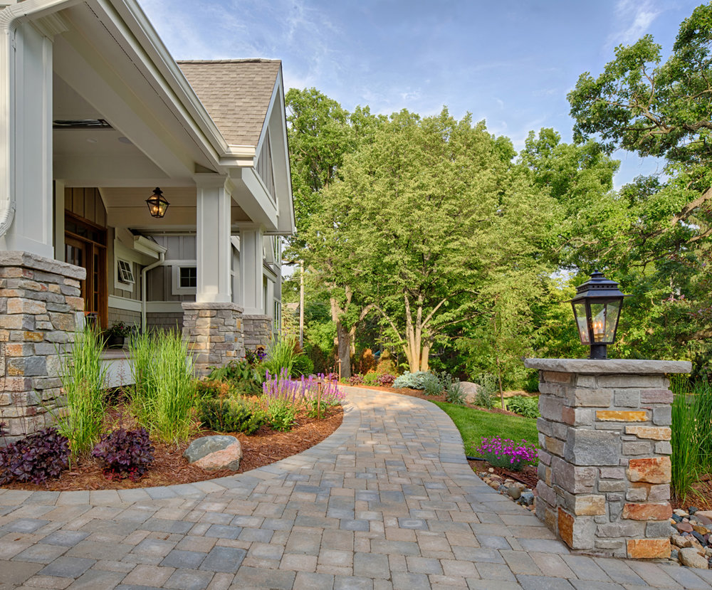 Chanhassen home with an entry! The beautiful stone pavers are a great match for the home facade and make a great curb statement.