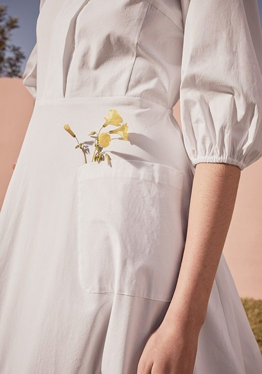 A very springtime pocket feel on this dress by Cuyana.