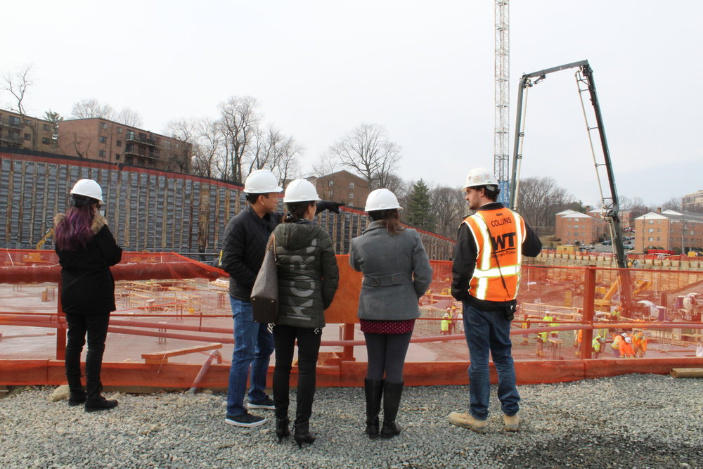 AHDC team members check out the future site of the Gateway, part of the larger West Alex development.