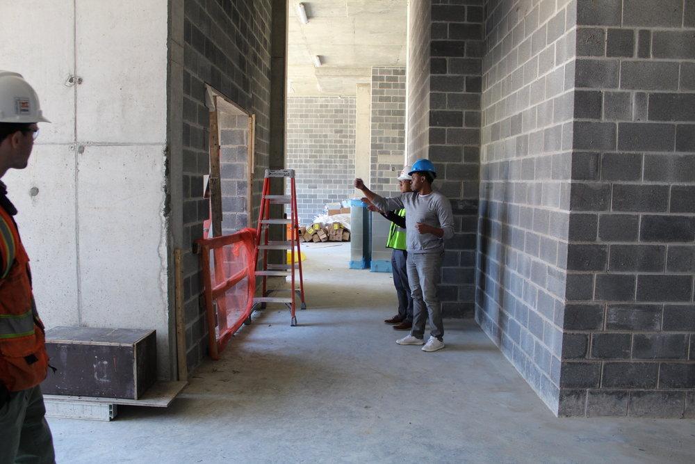 AHDC team members looking at the lobby entryway.