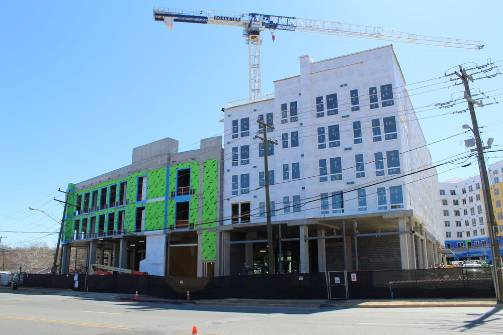 View from Beauregard Street. AHDC's future units are in the building on the right, with the white clad exterior. The main entrance for this building will be on the right hand side, first level. (The green clad potion of the building will be office, retail, and dining.)