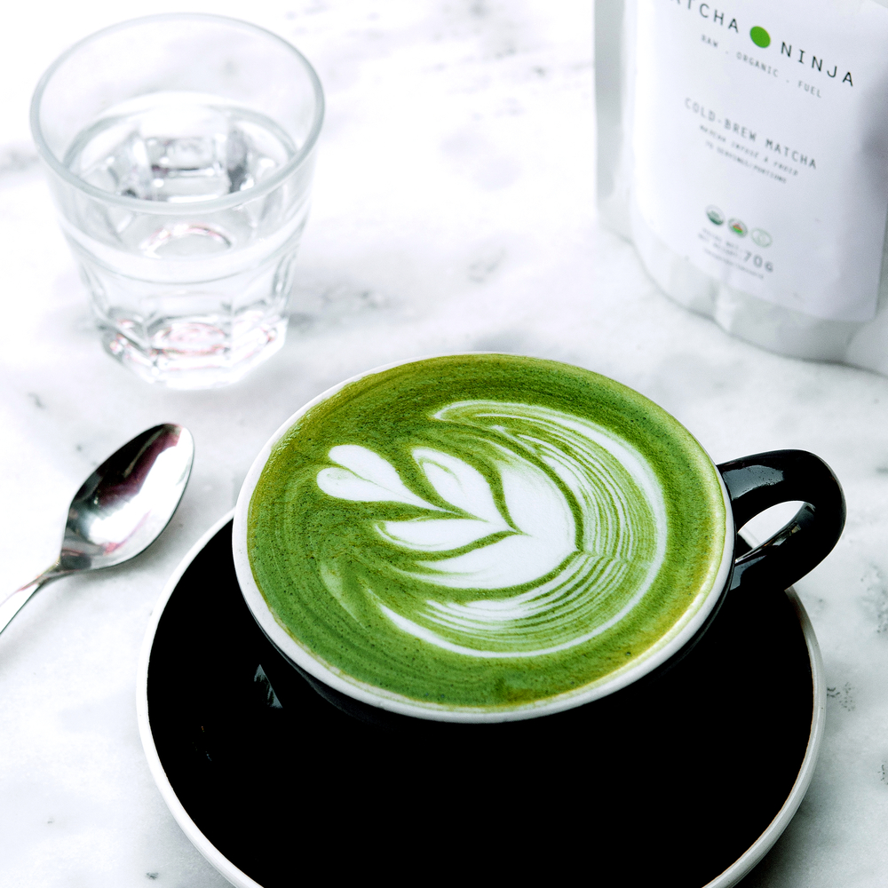 - Ingredients:½ cup hot water½ cup organic almond/ coconut milk 1/2 teaspoon Matcha Ninja1  tablespoon honey, maple syrup, or stevia to taste (optional)Method1. Measure ½ teaspoon Matcha Ninja to cup2. Next, add small amount of warm water to matcha and stir to form espresso like base3. Add 1/2 cup hot (not boiling) water to your mug filled with Matcha 4. Add sweetener5. Heat & froth your milk6. Add your heated milk
