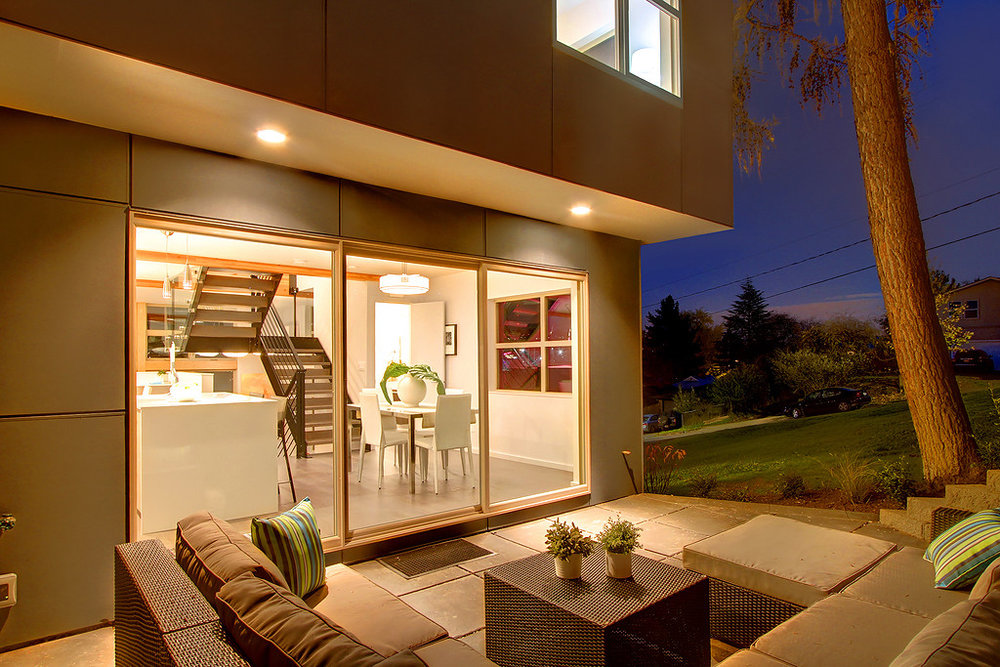 multiple opportunities to relax outside include a roof deck and a terrace adjacent to the kitchen.