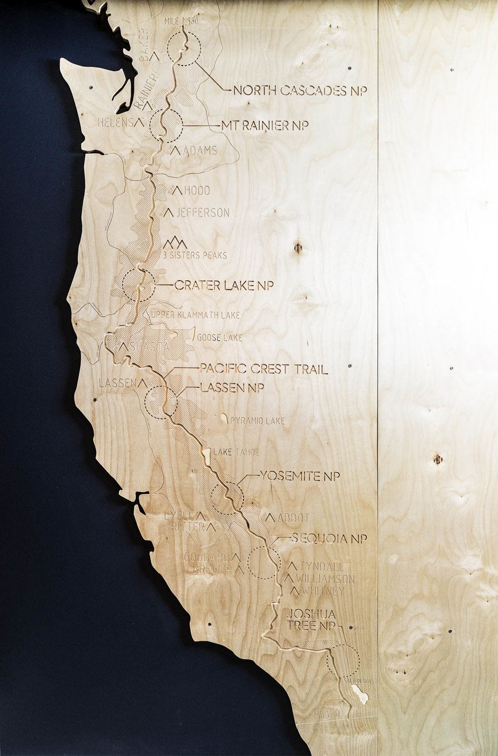 Computer-numeric-controlled (CNC) milling technology was used to produce a custom-designed plywood map of the Pacific Crest Trail for a waiting room wall.