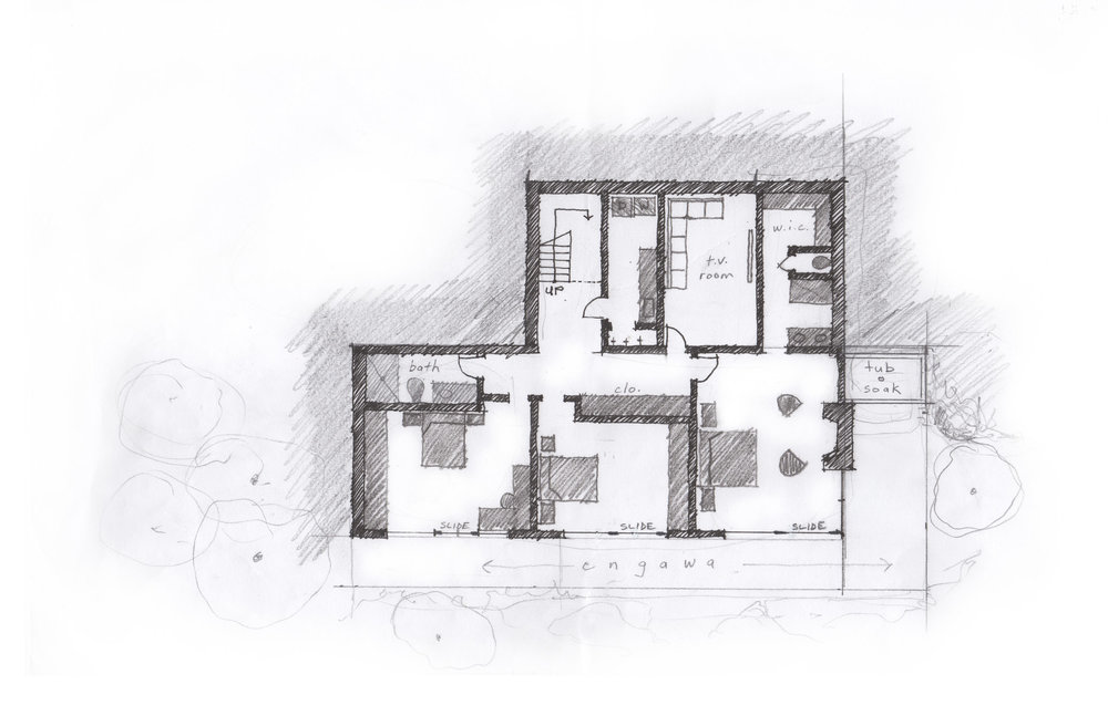 The lower level plan opens on to the engawa and garden while a Japanese soaking tub is nestled into the ground surrounded by landscaping and a rockery